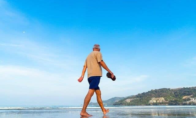 Retire on Rental Income - Walking on the Beach