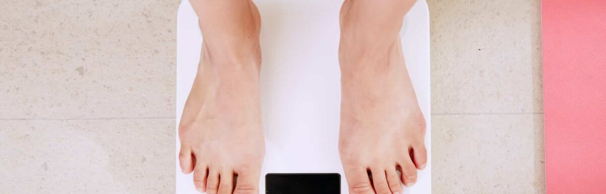 Woman on weighing scale getting paid to lose weight