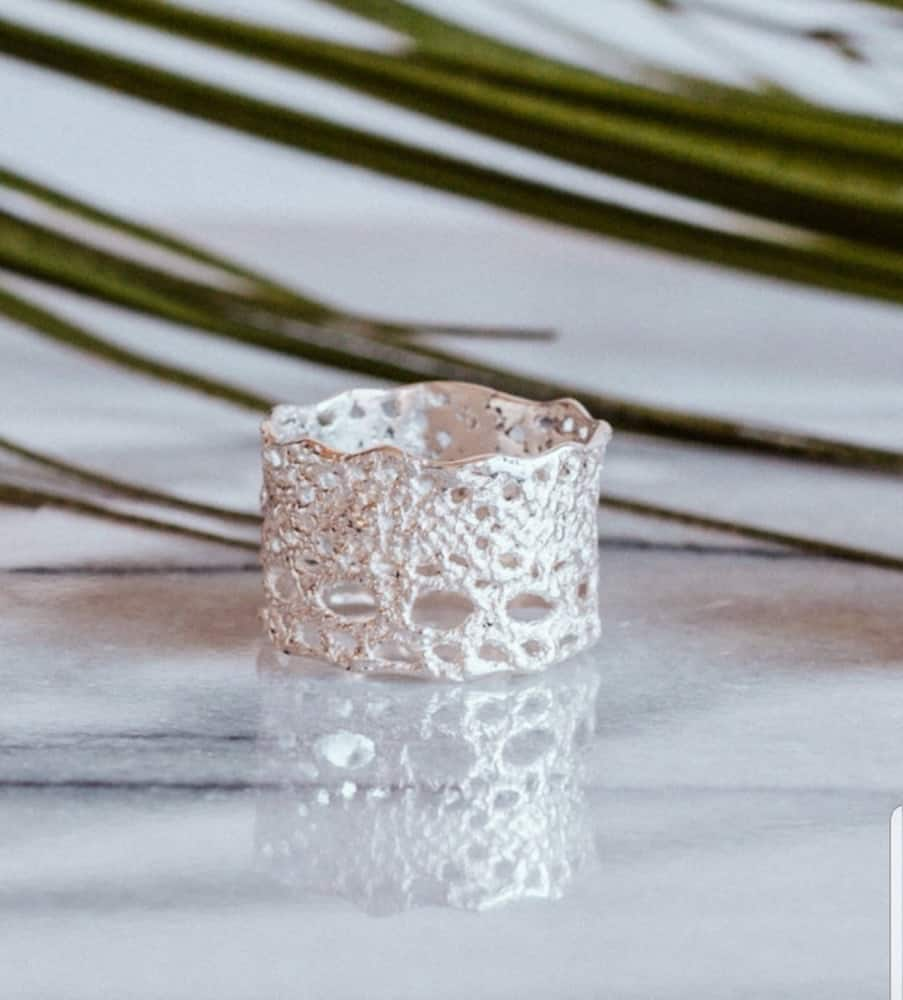 Professional photography showcases ring of antique lace cast in silver