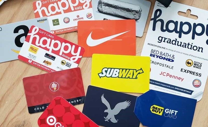A collection of gift cards on a wooden table