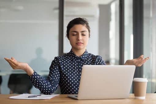 Calm Woman Meditating at Work