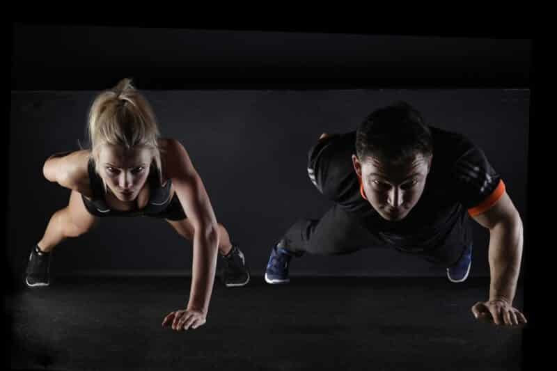 Personal trainer training a client