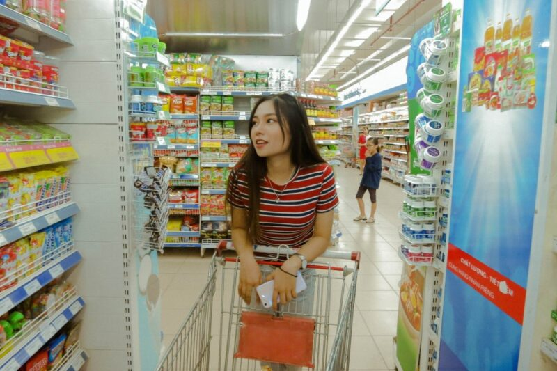 Young lady grocery shopping